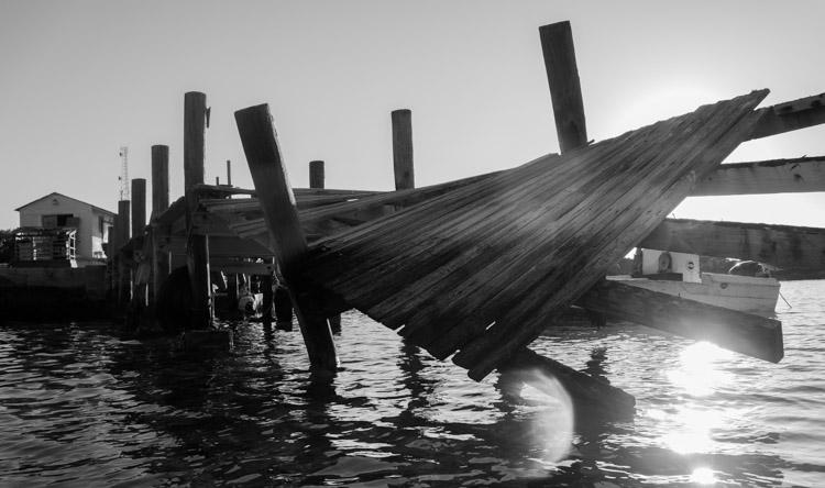 An old dock in the harbor of Little Farmer's Cay, Bahamas