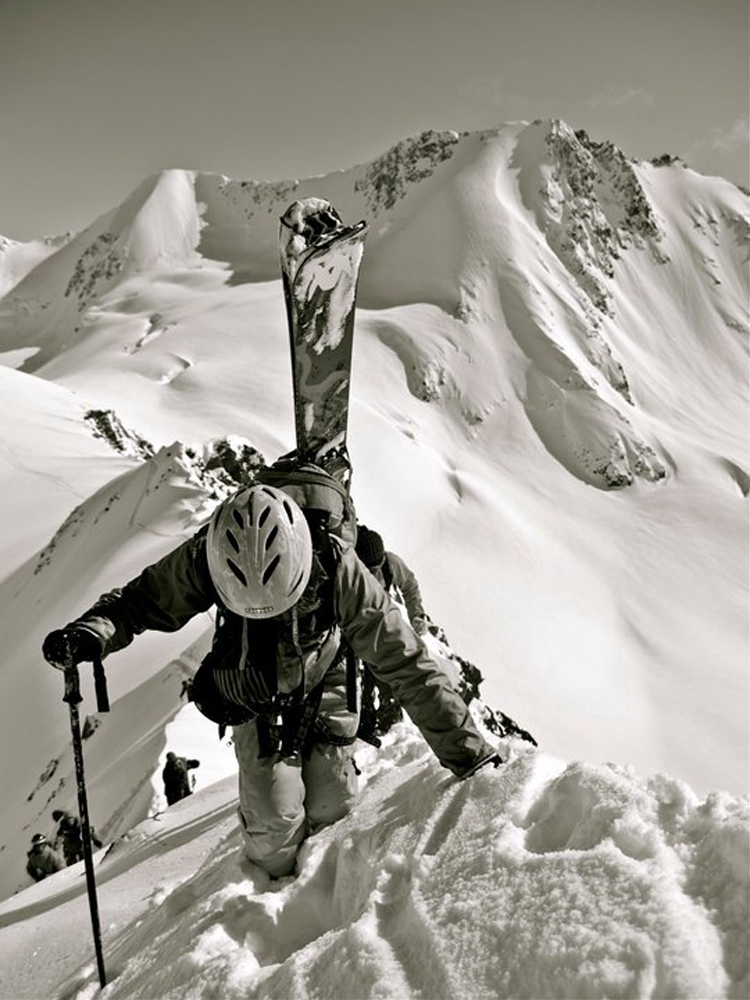 Straddling the ridge high above Crow Pass, Alaska, this is me expanding my comfort zone in pursuit of the deep.  Photo: Corky Still